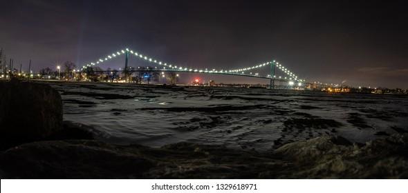 Detroit, Michigan/USA - 02-02-2019:  Ambassador Bridge brightly illuminated in the cold winter night