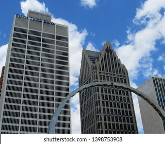 Detroit, Mich./USA-5/14/19: The Fifth Third Bank and Ally Bank signs top two skyscrapers. In the foreground is a circular sculpture on Hart Plaza called Transcendence.