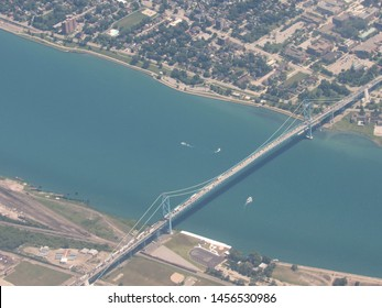 Detroit, Mich./USA-7/20/2019: The Ambassador Bridge, linking the U.S. (bottom of photo) and Canada, carries heavy truck traffic over the Detroit River.