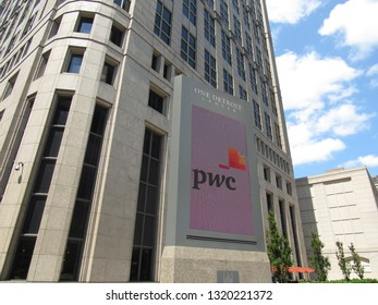 Detroit, Mich./USA-June 7, 2014: A sign outside One Detroit Center in downtown Detroit, showing PwC as a tenant.