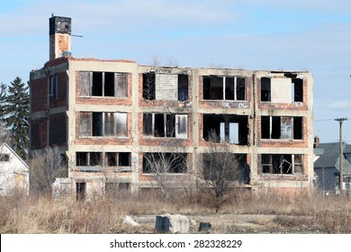 DETROIT, MI-MAY, 2015:  Abandoned and looted small school building in an inner city neighborhood near downtown.