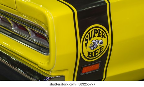 DETROIT, MI/USA - FEBRUARY 27, 2016: Close-up of 1969 Dodge Coronet Super Bee emblem and taillight at the Detroit Autorama, a showcase of custom and restored cars.