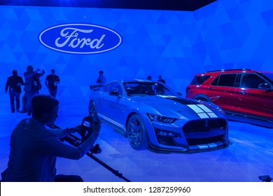 DETROIT, MI/USA - JANUARY 14, 2019: A 2020 Ford Shelby Cobra Mustang GT500 car at the North American International Auto Show (NAIAS), illuminated by Ford Blue Oval-colored tiles.
