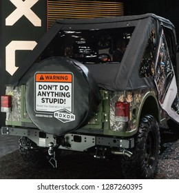 "DETROIT, MI/USA - JANUARY 14, 2019: ""Don't Do Anything Stupid"" sign on a Mahindra Roxor ORV, at the North American International Auto Show (NAIAS)."