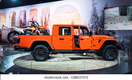 DETROIT, MI/USA - JANUARY 15, 2019: A 2020 Jeep Gladiator SUV with KTM dirt bikes at the North American International Auto Show (NAIAS).