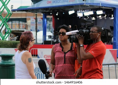 Detroit, MI/USA: July 29, 2019 – Reuters interviews local woman on Woodward Avenue in Detroit, outside Fox Theatre, location of CNN hosted debates for 2020 Democrat presidential candidates.