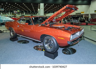 DETROIT, MI/USA - March 2, 2018: A 1970 Plymouth Barracuda with Shaker hood scoop, on display at the Detroit Autorama, a showcase of custom and restored cars.