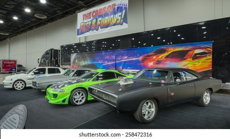 "DETROIT, MI/USA - MARCH 6, 2015: Cars of the ""Fast and Furious"" movies: 1995 VW Jetta, 1970 Chevy Chevelle, 1995 Mitsubishi Eclipse, 1970 Dodge Charger, on display at the Detroit AutoRama."