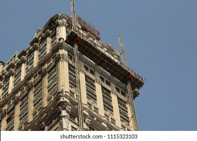 Detroit, MI/USA: Sept. 2, 2017 – Landmark Book Tower with scaffolding against blue sky. The limestone building with its intricate ornamentation, built in 1926 by the Book brothers, is being cleaned.
