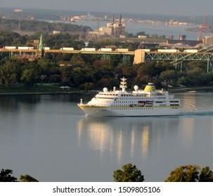 Detroit, MI/USA-Sept. 20, 2019: Passenger ship S.S. Hamburg on the Detroit River after passing under the Ambassador Bridge. Ontario, Canada is the backdrop.