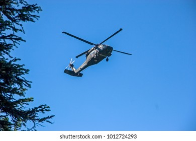Detroit, Oregon - 7/13/2005: An Oregon National Guard helicopter (HH-60M Black Hawk) lifting an injured hiker from the Willamette National forest near Detroit.