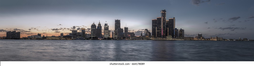 Detroit skyline at dusk with river