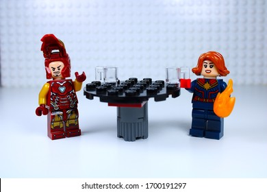 DETROIT, USA - APRIL 11, 2020: Iron man dates Captain Marvel. Lego mini-figure love story. Tony stark waves his hand as Captain Marvel lights the room with her fire power.