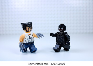 DETROIT, USA - APRIL 11, 2020: Wolverine attacks Venom. Lego mini-figures. Wolverine points his Steel claws at Venom.
