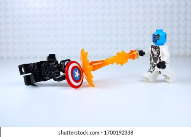 DETROIT, USA - APRIL 11, 2020: Venom vs. Nebula. Lego Mini-figures. Nebula throws fire at Venom.