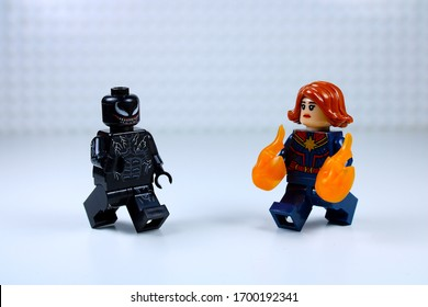 DETROIT, USA - APRIL 11, 2020: Venom vs. Captain Marvel. Lego mini-figures. Captain Marvel turns on her fire power.