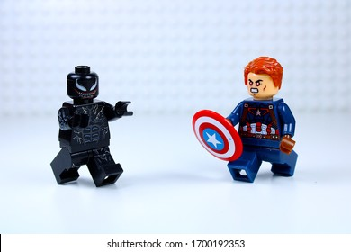 DETROIT, USA - APRIL 11, 2020: Venom versus Captain America. Lego Mini-figures. Captain America attacks Venom with his shield.