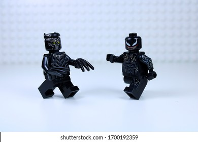 DETROIT, USA - APRIL 11, 2020: Black Panther versus Venom. Lego mini-figures. Lego Venom attacks Black Panther.