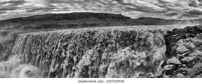Dettifoss is the most powerful waterfall on Iceland and in the whole Europe. It is located in Jokulsargljufur National Park  on the river Jokulsa a Fjollum. Panorama in black and white
