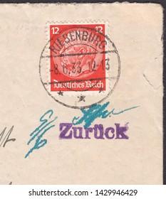 """DEUTSCHES REICH - CIRCA 1933:A stamp printed in Deutsches Reich,shows Paul von Hindenburg (1847-1934), 2nd President.Postmark of the city Riesenburg and """"return"""", circa 1933"""