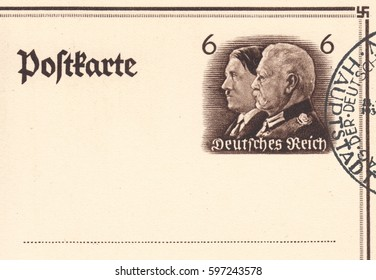 DEUTSCHES REICH - CIRCA 1933:A stamp printed in Deutsches Reich,shows Portrait of the German military and political figure Adolf Hitler and Paul von Hindenburg on old post card, circa 1933.