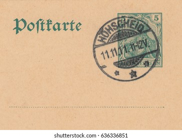 DEUTSCHES REICH-CIRCA 1911:A stamp printed in Germany,shows Legendary warrior women of the Valkyries,crowned with the Imperial crown on old post card.Stamp with the sacred date of 11.11.11,circa 1911.