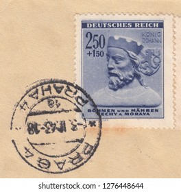 DEUTSCHES REICH-CIRCA 1943:A stamp printed in Bohemia and Moravia, shows Portrait of king Johann von Luxemburg on fragment old postal envelope.Postmark of the city Praga, circa 1943