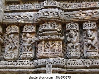 Devadasis, temple dancers, carvings on weathered red sandstone