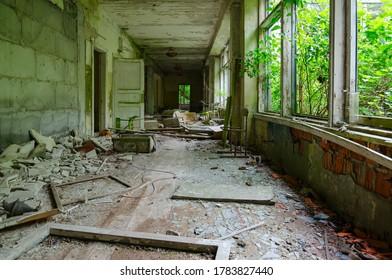 Devastation in corridor of abandoned school in large resettled village of Pogonnoye in exclusion zone of Chernobyl nuclear power plant, Khoiniki district, Gomel region, Belarus