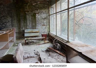 Devastation in hall of hospital No. 126, abandoned ghost town Pripyat in Chernobyl NPP alienation zone, Ukraine