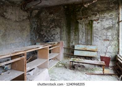 Devastation in hall of hospital No. 126, dead abandoned ghost town of Pripyat in Chernobyl NPP alienation zone, Ukraine