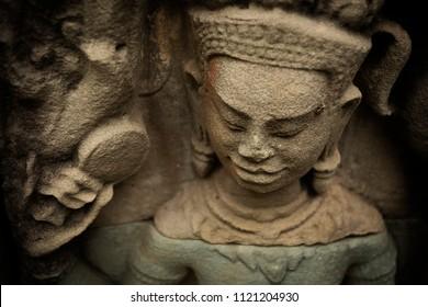 Devata holding a mirror at Bantey Prei temple in Angkor