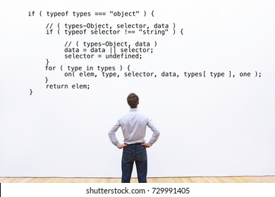 developer looking at the code javascript, abstract coding concept, learning programming