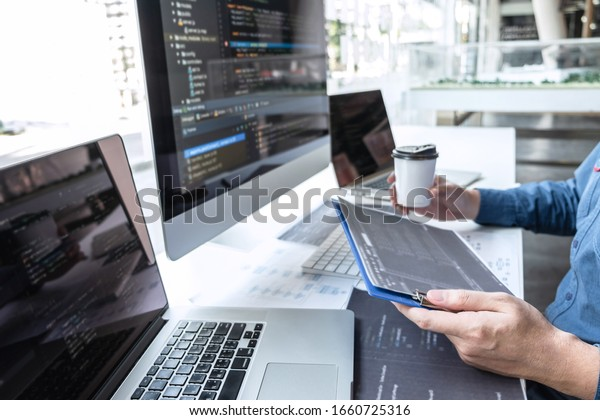 Developer programmer working on project in software development computer in IT company office, Writing codes and data code website and coding database technologies to find solution to problem.