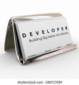 Developer word on business cards in a holder to advertise your services and network with professionals, customers and prospects