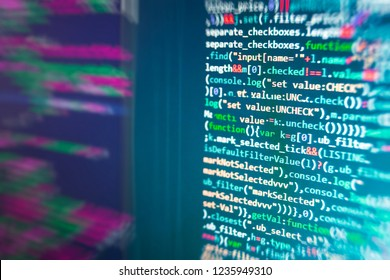Developer working on websites codes in office. Big data database app. Monitor closeup of function source code. Binary digits code editing. Javascript functions, variables, objects.