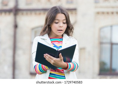 Developing her reading skills. Little girl read book outdoor. Small kid enjoy reading day. Adorable bibliophile. Child imagination. Home reading. School and education. Reading makes her smart.