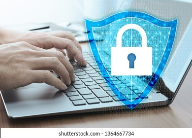 Developing network security system. Internet data security concept.Businessman using laptop.