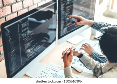 Developing programmer Team Development Website design and coding technologies working in software company office