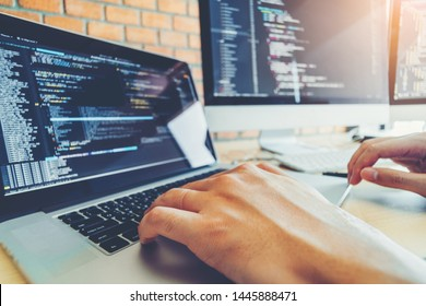 Developing programmer Team Development Website design and coding technologies working in software company office - Shutterstock ID 1445888471