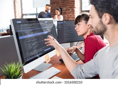 Developing programming and coding technologies. Website design. Programmer working in a software develop company office. - Shutterstock ID 1016500210