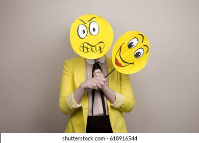 Development of emotional intelligence. The girl plays with smiles, builds faces.