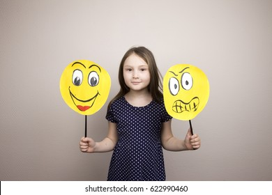 Development of emotional intelligence. The girl plays with smiles, builds erysipelas. Laughter, fun, anger. Teaching a child.