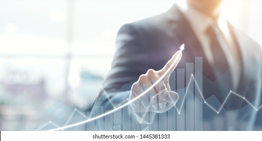 Development and growth concept. Businessman plan growth and increase of positive indicators in his business.