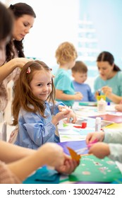 Development learning children in preschool. Children's project in kindergarten. Group of kids with teacher together.
