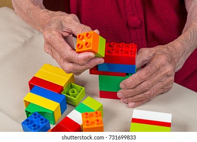 Development of an old woman with colored plastic blocks