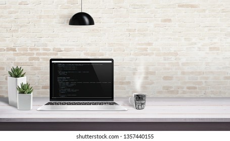 Development studio concept. Laptop with script code. Free space for text beside.