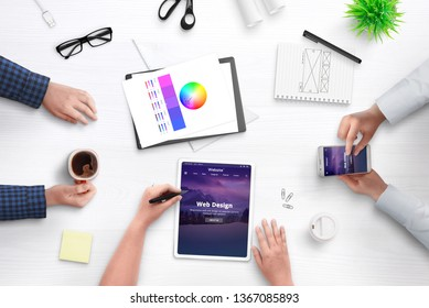 Development theme for content managment system concept. Office desk, flat lay with people, mobile devices, papers, cofffee.