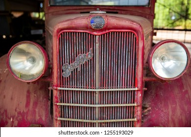 DEVENISH, VICTORIA, AUSTRALIA - 27 NOVEMBER 2018: Detail shot of radiator grill and rounded headlights of an old 1930's Bedford Truck in the Devenish rural museum in central Victoria.
