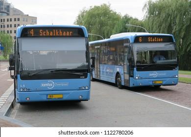 Deventer, Netherlands, 08-18-2017,  two busses at the bus station in Deventer, Netherlands